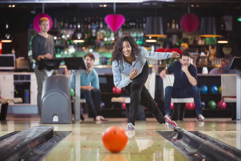 Young teen girl bowling